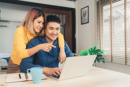young asian couple with laptop