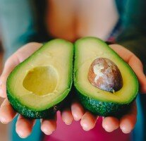 Photo of a ripe avocado in hands